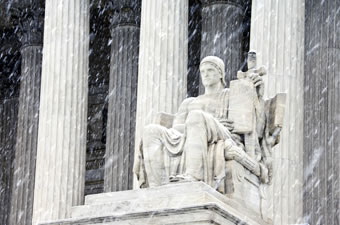 Supreme Court statue in snowfall